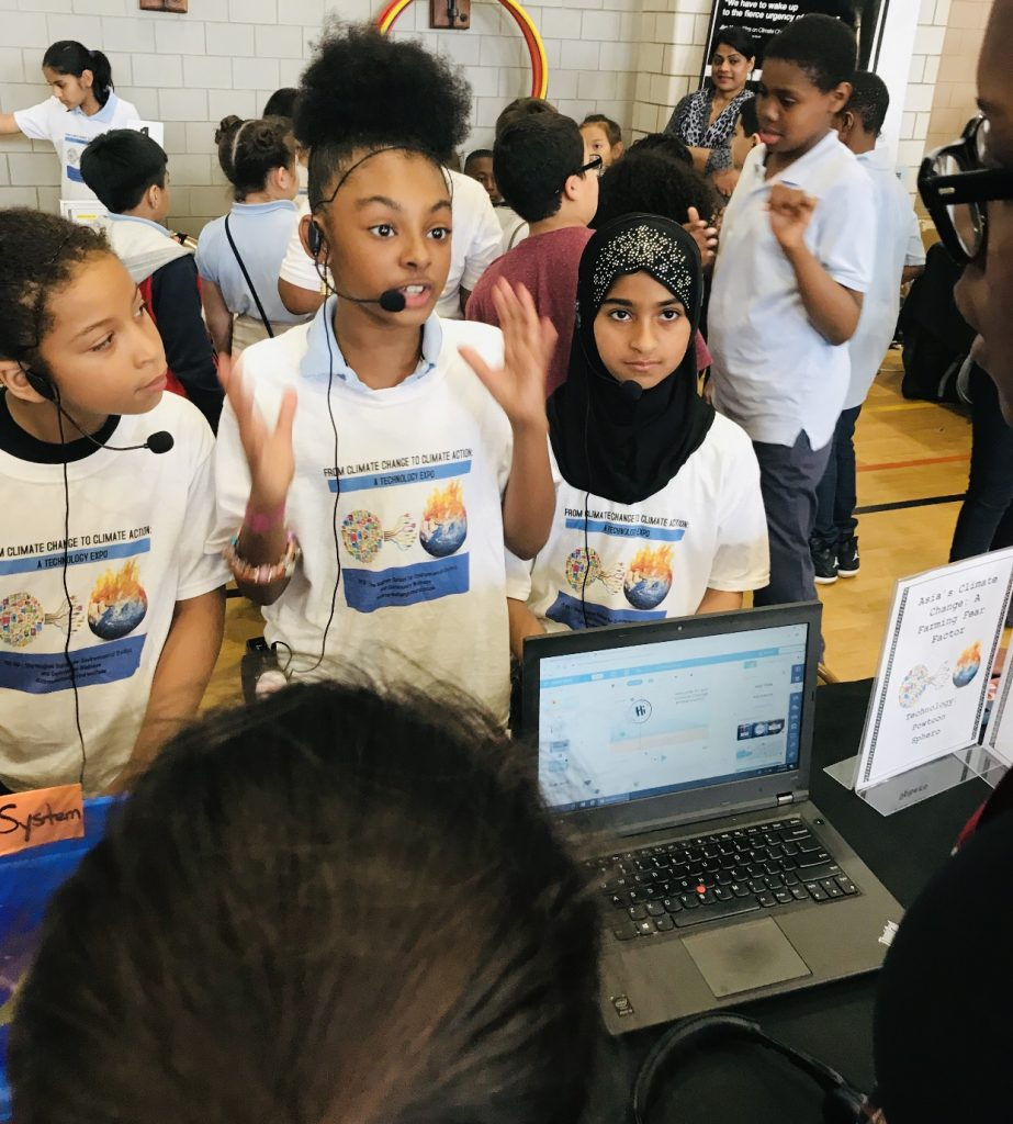 Third grade students present their yearlong culminating research to peers and community members at PS90's From Climate Change to Climate Action – A Technology Expo. The students analyzed the harmful effects of climate change on Asia's farming systems and offered their solutions.